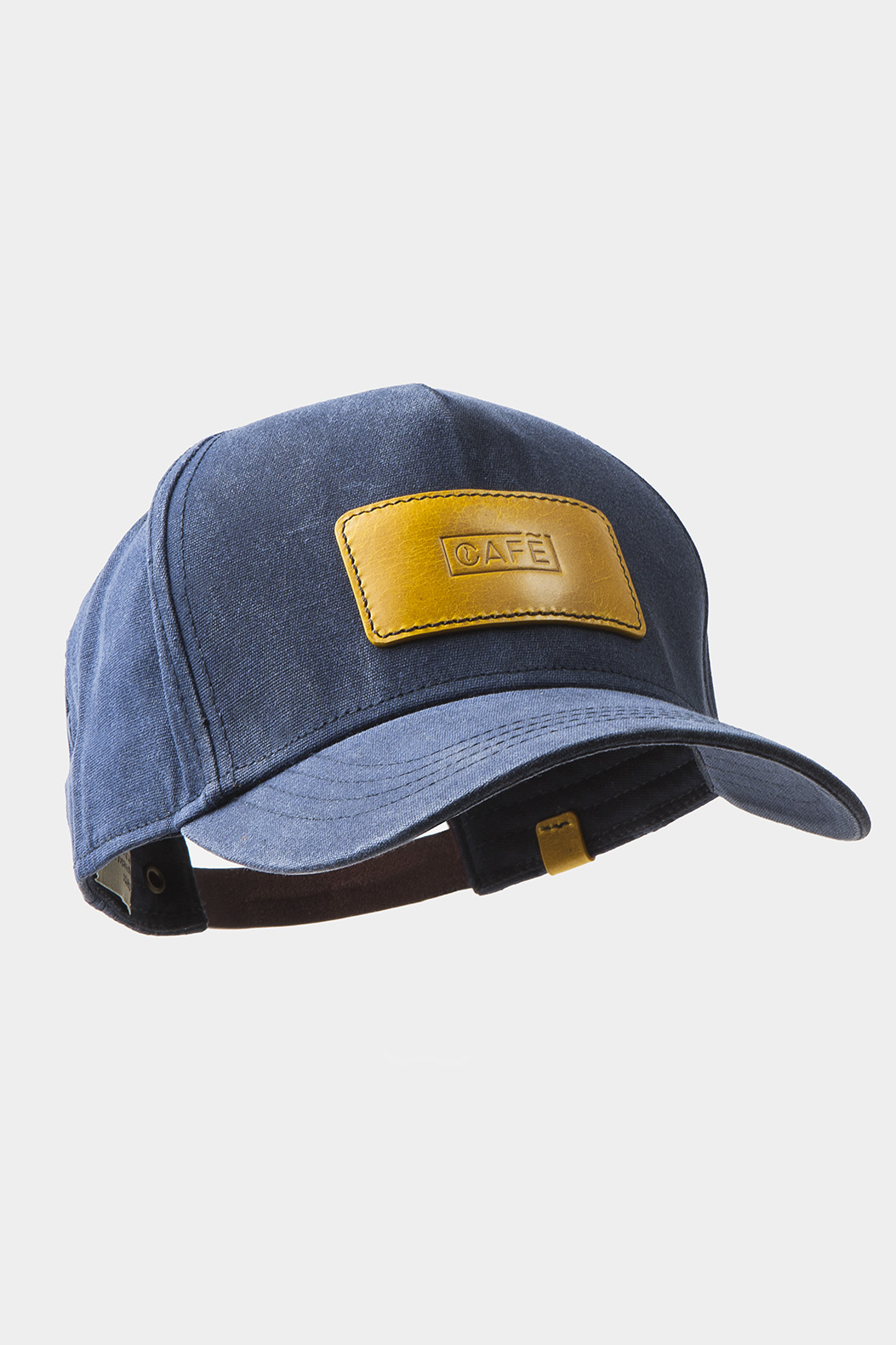 Yellow cap with leather black patch.
