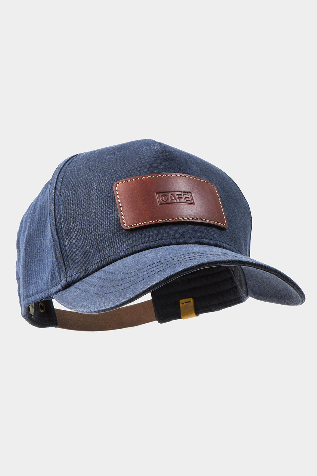 Blue cap with leather brown patch.