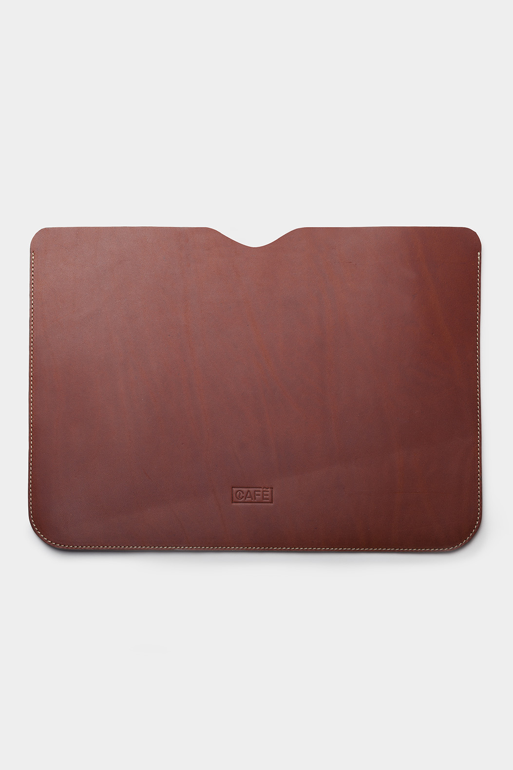 Leather laptop sleeve handcrafted by artisans in Spain.